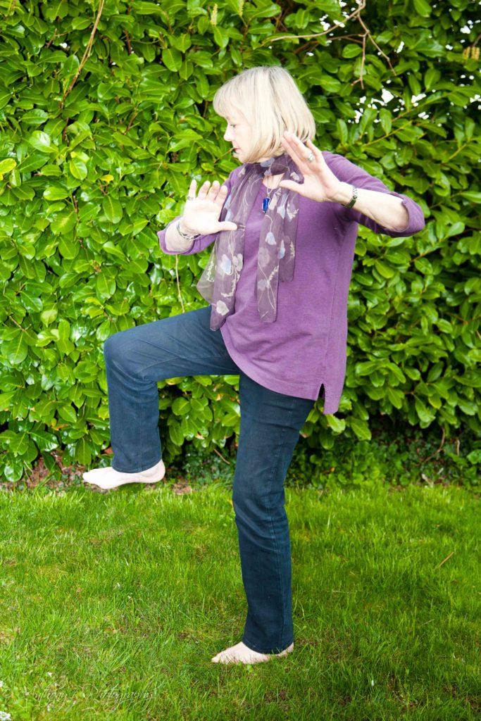 Senior woman doing tai chi.