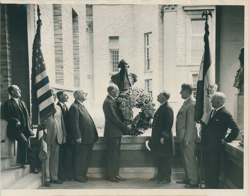 The bust of George Washington decorated with a wreath for Constitution Day, 1927. Bronx Community College Archives.