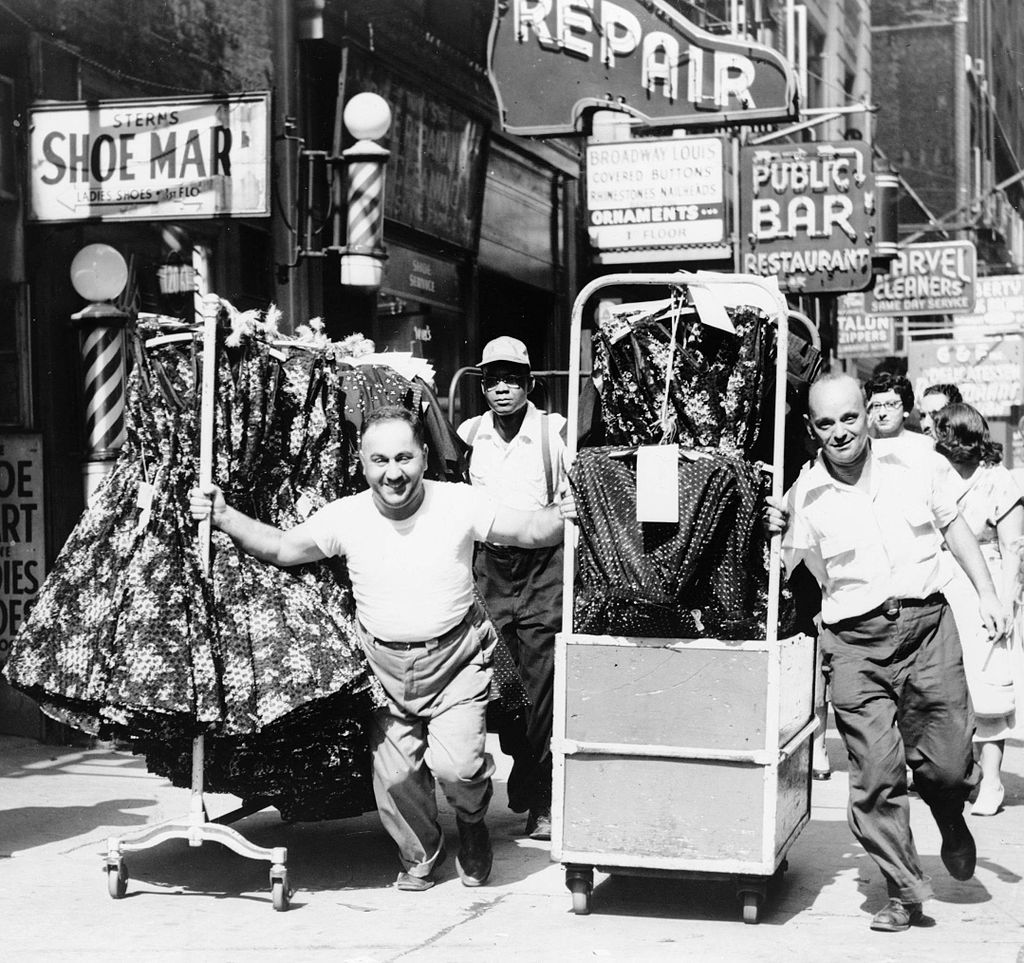 Al Ravenna,  Men pulling racks of clothing on busy sidewalk in Garment District, New York City , 1955, photograph, Library of Congress, Washington.