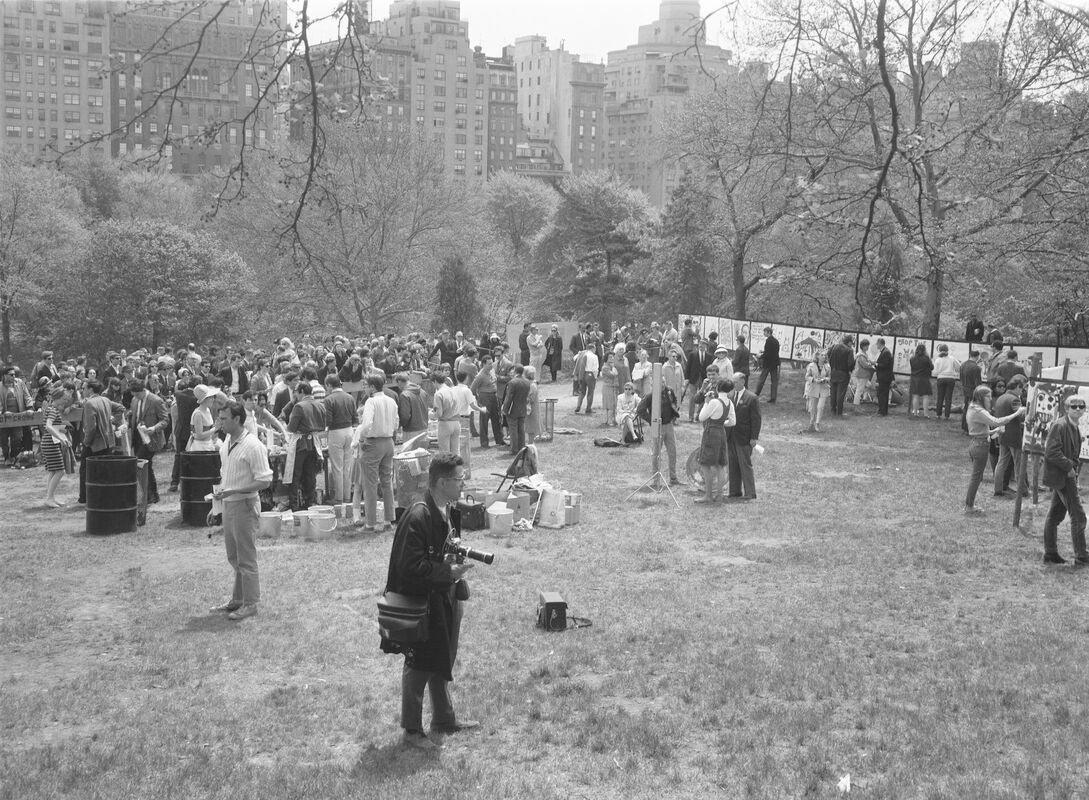 """Cartoon Performance, May 15, 1966. The first happening in Central Park involved the installation of a 105-foot-long canvas across the lawn known as Cedar Hill for the public to paint on. Capturing the open-ended nature of the happening, the press release for the event stated that """"The performance will end when the painting is finished, or when it rains, or when it grows too dark to continue."""""""