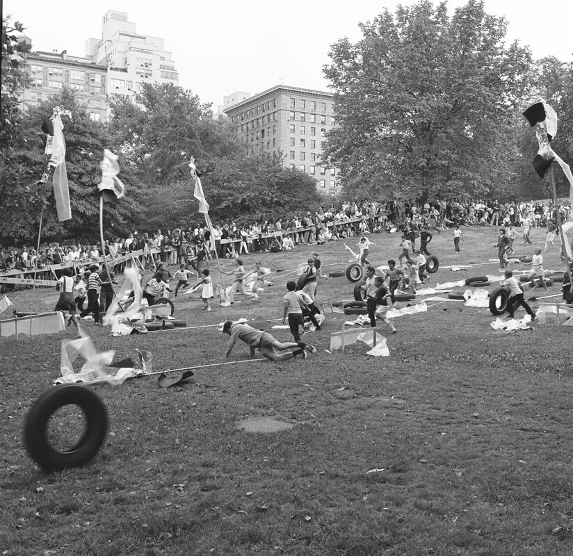 Allan Kaprow's happening Towers, Fourth Avant Garde Festival, September 9, 1966. The artist instructed participants to roll tires down a hill and aim to knock over wooden posts draped with plastic, fabric, and tin foil. At the felling of each post, a horn blasted.