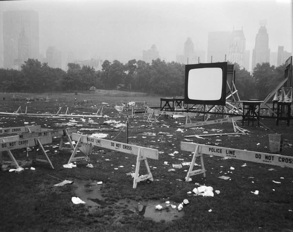 The Day After the Moon-In, July 21, 1969. The five-thousand spectators who gathered to watch footage of the moon landing and participate in other celebratory events were not deterred by heavy rains, but the event and the weather left the Sheep Meadow trashed and eroded.