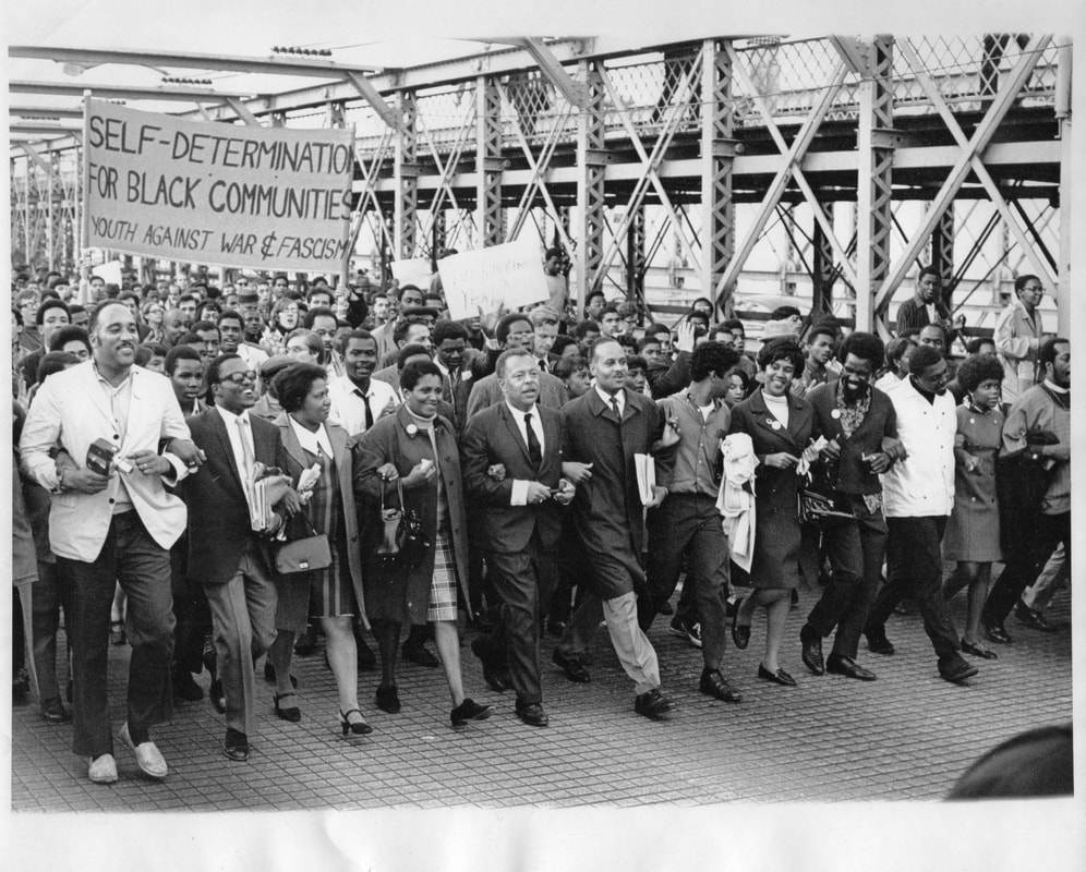 The Ocean Hill-Brownsville Governing Board and supporters march over the Brooklyn Bridge, March 1969. Photo courtesy of Heather Lewis.