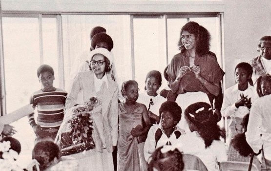 Rosa Parks, left, visits a classroom at the Oakland Community School. School director Ericka Huggins is at right. Collection of Ericka Huggins, via IPHP.