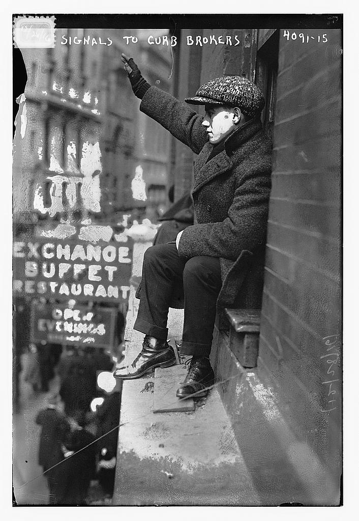 Signaling from the window to brokers below. Image courtesy of the Library of Congress.