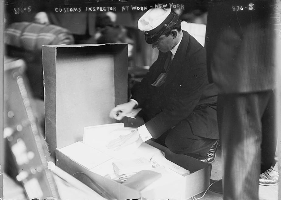 Figure 3:  Customs Inspector at Work,  NDL pier, New York, 1909. Library of Congress.