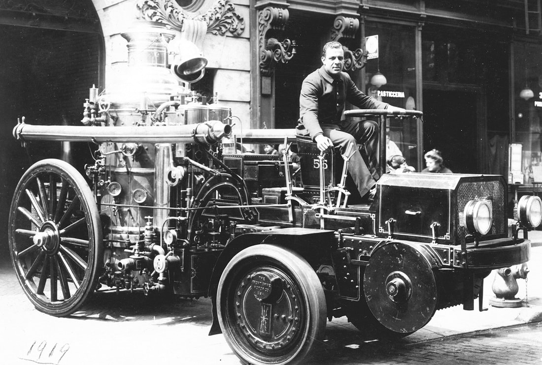 Wesley Williams driving an early fire engine, ca. 1920.  Photographs and Prints Division, Schomburg Center for Research in Black Culture, New York Public Library.