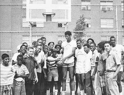 Kareem Abdul-Jabbar (center) and Emmette Bryant (to his right) kick off the summer basketball clinic at the Marcy Houses in Bedford-Stuyvesant, Brooklyn, July 23, 1968. New York City Housing Authority Collection, LaGuardia and Wagner Archives.