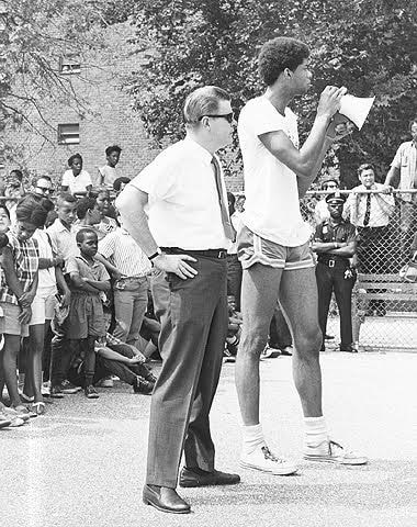 Kareem Abdul-Jabbar kicks off the summer basketball clinic at the Marcy Houses in Bedford-Stuyvesant, Brooklyn, July 23, 1968. New York City Housing Authority Collection, LaGuardia and Wagner Archives.