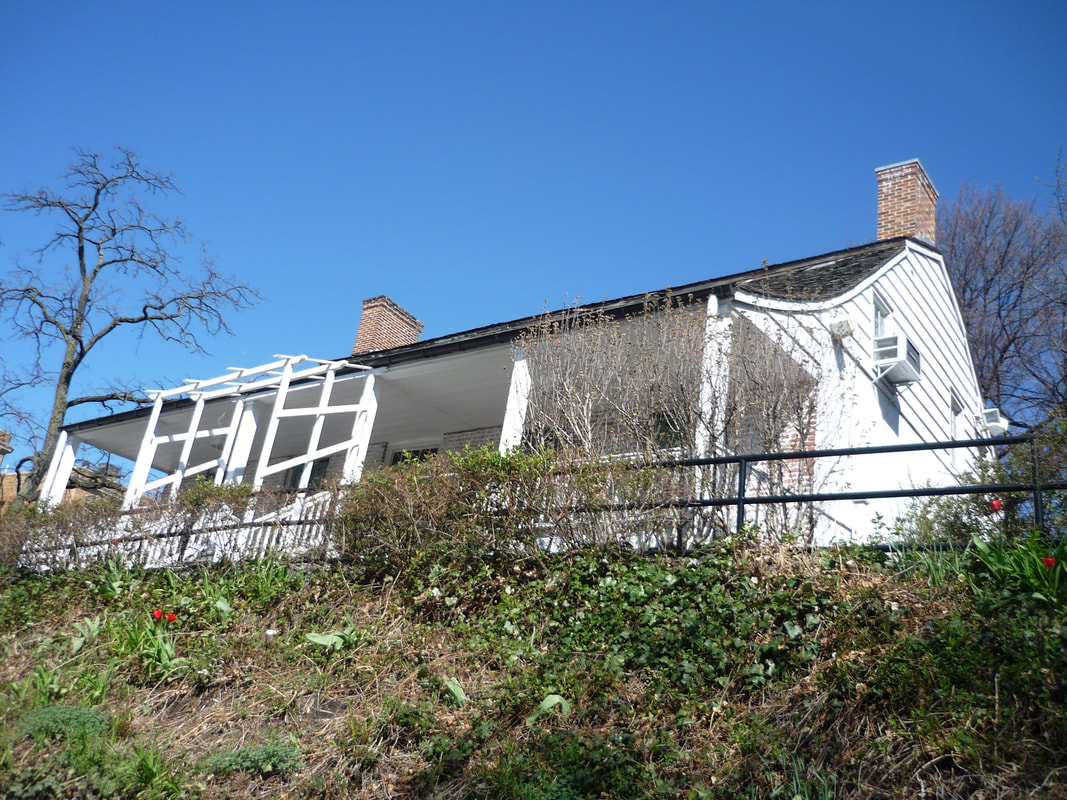 View of the Dyckman Farmhouse Museum from Broadway.