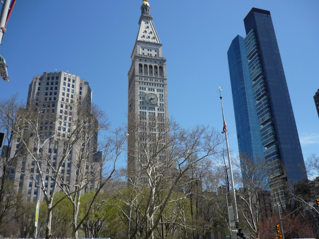 Three generations of architecture flanking Madison Square Park.