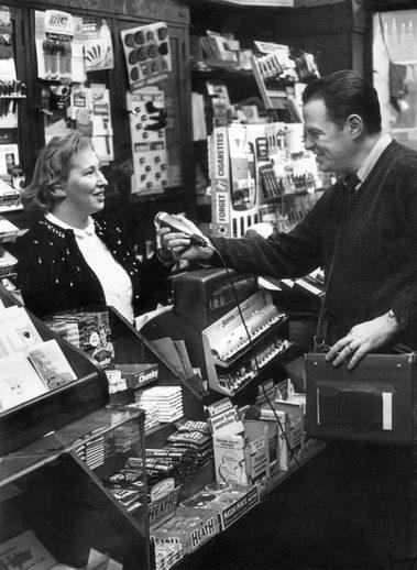 Tony interviews a shopkeeper. New York, NY.