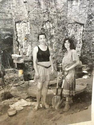 Sue Strande and Marisa DeDominicis gardening in Sunnyside Garden 543 E 13 Street located between 2 squats.