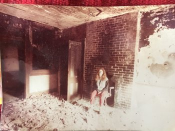 Marisa DeDominicis in 539 East 13 Street, apt. 3a, April 1984. Demolition of the ceiling plaster had just been completed.