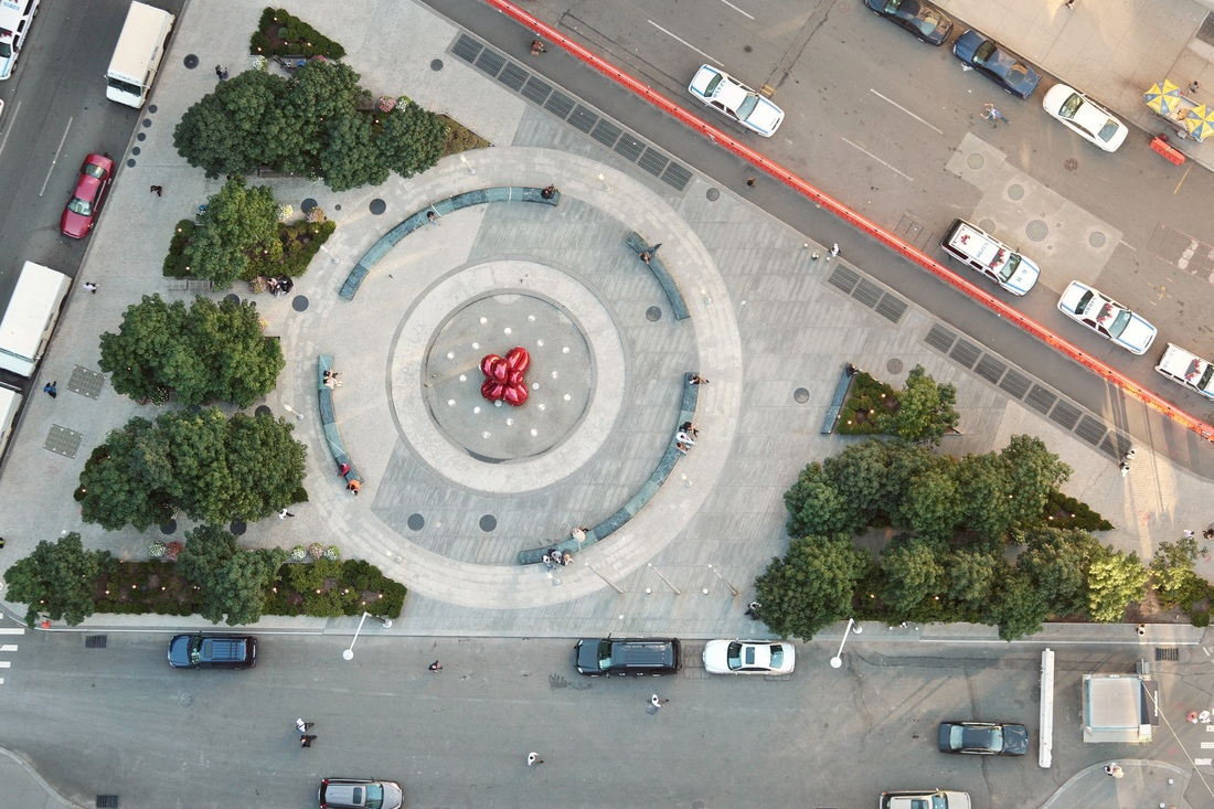 Landscape architect Ken Smith designed the triangular park in front of 7 WTC, formed by the intersection of Greenwich Street and West Broadway. Jeff Koons' whimsical Balloon Flower (Red) sculpture is its centerpiece. Photo: Joe Woolhead/Silverstein Properties