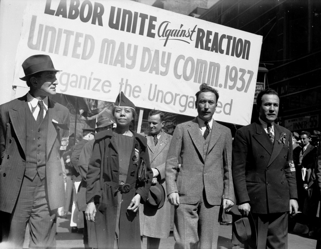 Edith Ransom of ILGWU Local 22 marching in the 1937 May Day Parade. Charles Zimmerman manager of Local 22 is to her right.  Source: The Kheel Center for Labor-Management Documentation and Archives.