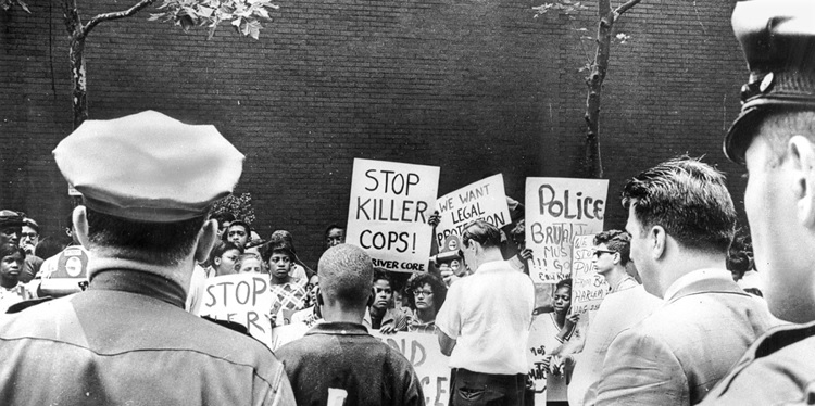 Police observe as demonstrators on East 67th Street protest the killing of James Powell. Photo by Marion S. Trikosko. Library of Congress, Prints and Photographs Division, U.S. News & World Report Magazine Collection (LC-U9-12259 frame 1).