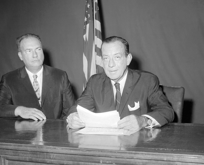 Mayor Robert Wagner, with Police Commissioner Michael Murphy (left) at his side, addresses the citizens of New York in a televised speech. Bettmann/ CORBIS.