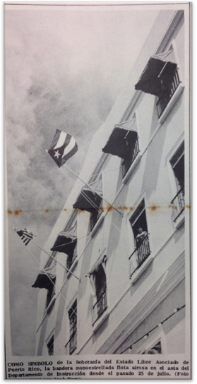 """A caption from the September 1952 edition of Educación reads: As a symbol of the sovereignty of the Commonwealth of Puerto Rico, the single-starred Puerto Rican flag gracefully waves in the air on the flagpole of the Department of Public Instruction since last July 25th. However, it was illegal under the """"Gag Law"""" for Puerto Rican citizens to own or fly their own flag, sing patriotic songs, or speak of independence until 1957, a prohibition passed by Muñoz's Partido Popular Democrático (PPD) intended to quell the independence movement."""