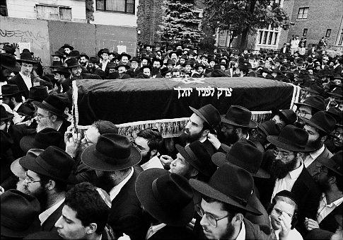 Yankel Rosenbaum's casket is carried in a public funeral through Crown Heights