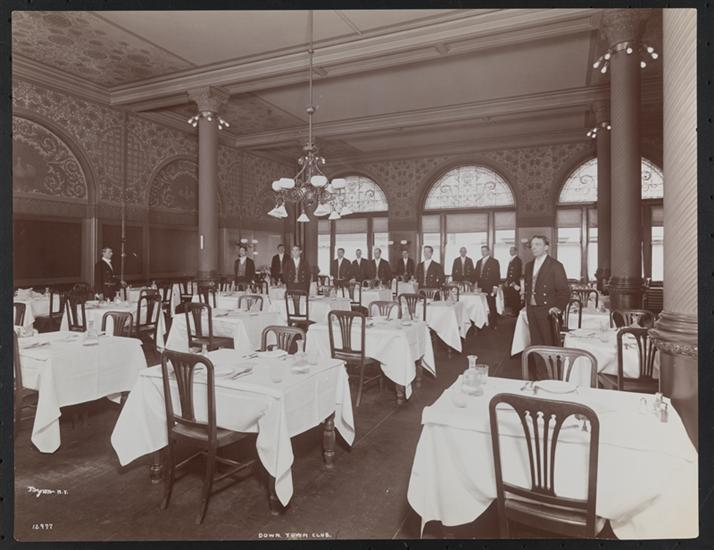 Waiters standing in the main dining room of the Down Town Association, Pine Street, 1902: Byron Collection, Museum of the City of New York. The Byron Collection includes several other behind-the-scenes photographs of the Down Town Association.