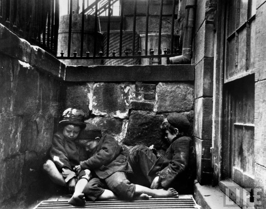 Children sleeping on Mulberry Street. One of Jacob Riis' photographs, circa 1890.
