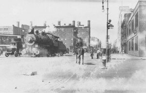 Steam engine on Eleventh Avenue, running through one of the most crowded neighborhoods in the city. (Milstein Division of United States History, The New York Public Library, Astor, Lenox, and Tilden Foundations)