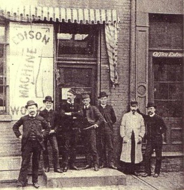 Group of men standing in front of the Edison Machine Works on Goerck Street in New York around the time that Tesla worked there. Tesla is not in the group. From Nikola Tesla, Notebook from the Edison Machine Works (Belgrade: Nikola Tesla Museum, 2003), 11.