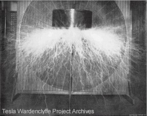 """""""Tesla's system of electrical power transmission through natural media. — View of model transformer, or """"oscillator,"""" photographed in action. -- Actual width of space traversed by the luminous streamers . . . over sixteen feet. . . . Estimated electrical pressure two and one-half million volts."""" From Electrical Review, supplement, 26 Oct. 1898, in TC 13:127. Available at Tesla Wardenclyffe Project Archives, file:///Users/wc4p/Desktop/picture05.htm."""