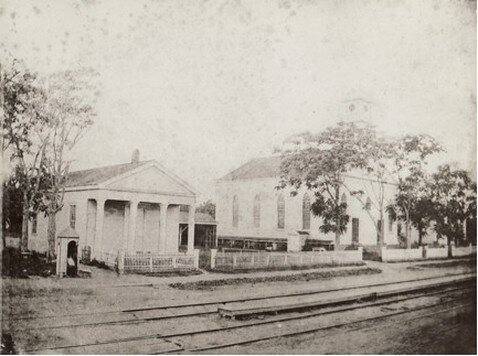 An 1879 view of the Reformed Dutch Church of Gravesend (right, built 1833) and adjacent lecture room (left, built 1850s). West side of Gravesend (now McDonald) Avenue between Village Road North and Gravesend Neck Road,