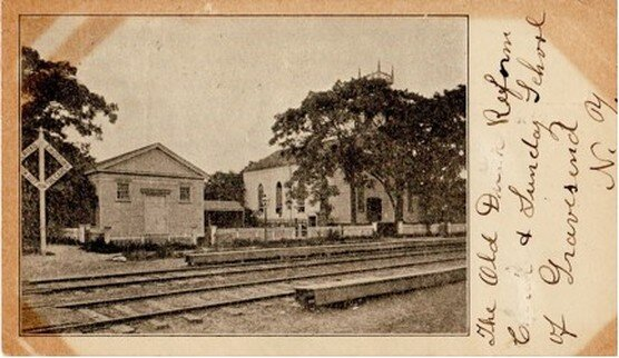 Private mailing card, printed 1898-1901, showing the 1833 Reformed Dutch Church of Gravesend and adjacent 1850s lecture room prior to their removal from Gravesend (McDonald) Avenue in 1893. Compare altered lecture room with Figure 1 and note railroad crossing sign at the corner of Gravesend Neck Road.
