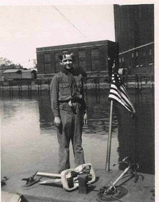 BILL ISECKE IN BOY SCOUT UNIFORM, ACROSS FROM THE CON ED PLANT AT SHERMAN CREEK NEAR DYCKMAN STREET AND THE HARLEM RIVER