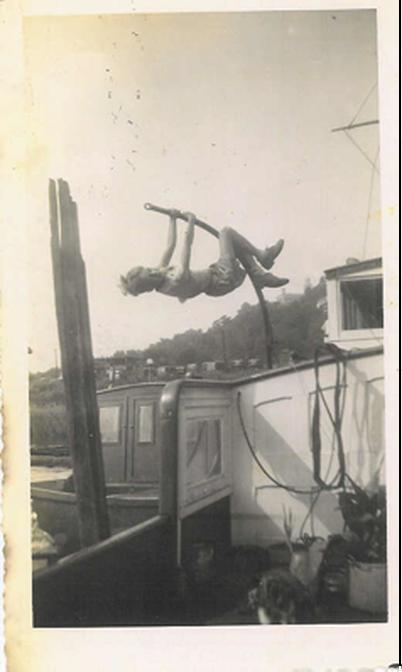 BILL'S LITTLE BROTHER, CONRAD ISECKE, SWINGING FROM THE NE-WI-MA'S DAVIT AT DYCKMAN STREET BERTH