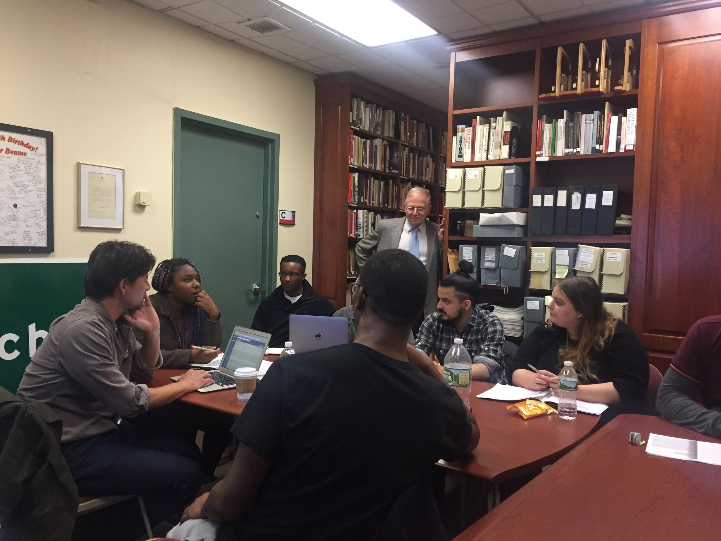 Faculty and staff guide discussions of weekly readings on the history of public housing. Photo by Molly Rosner.