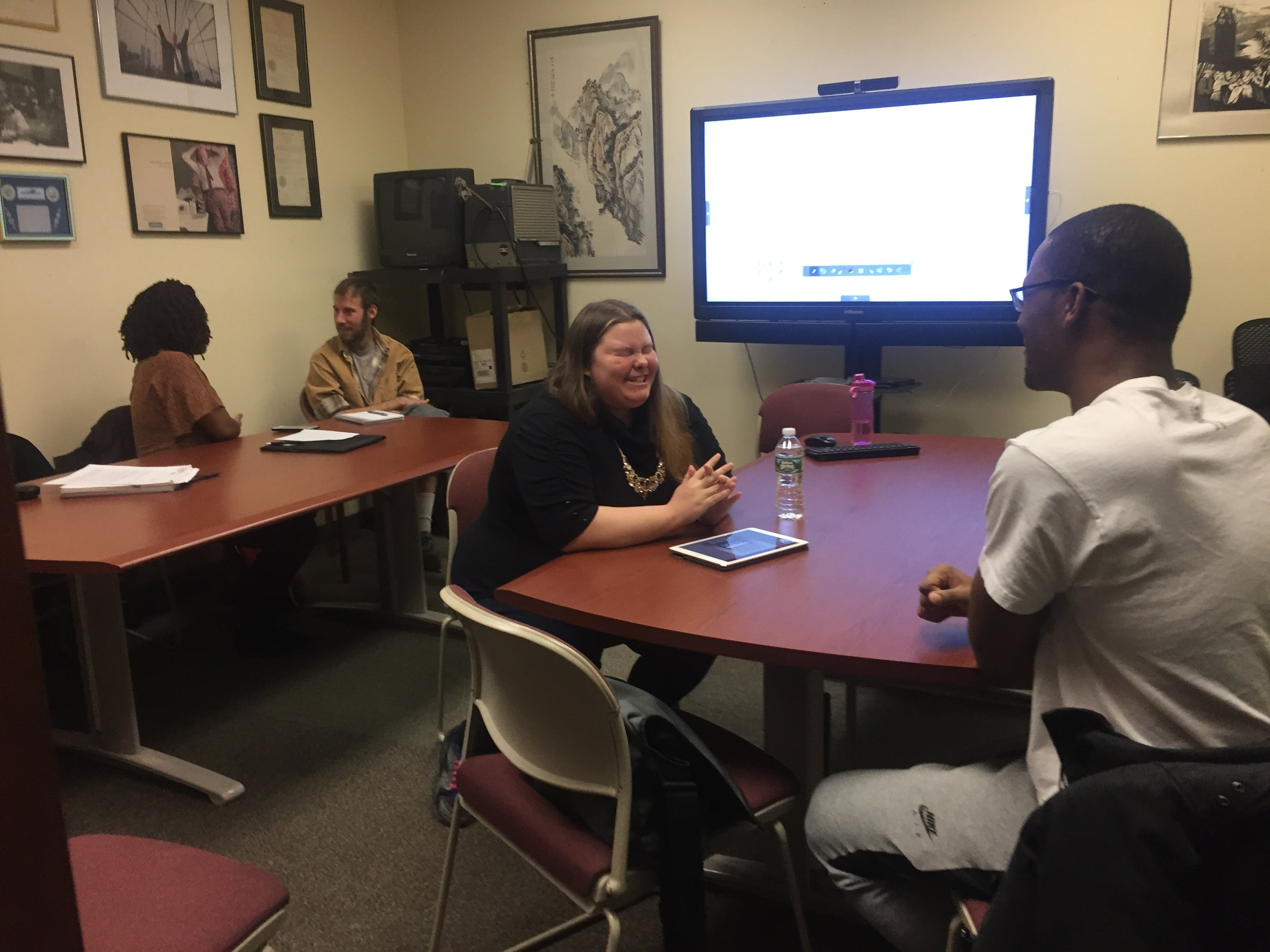 A student cringes as she attempts to interview her peer during a workshop at the LaGuardia and Wagner Archives. Photo by Molly Rosner.