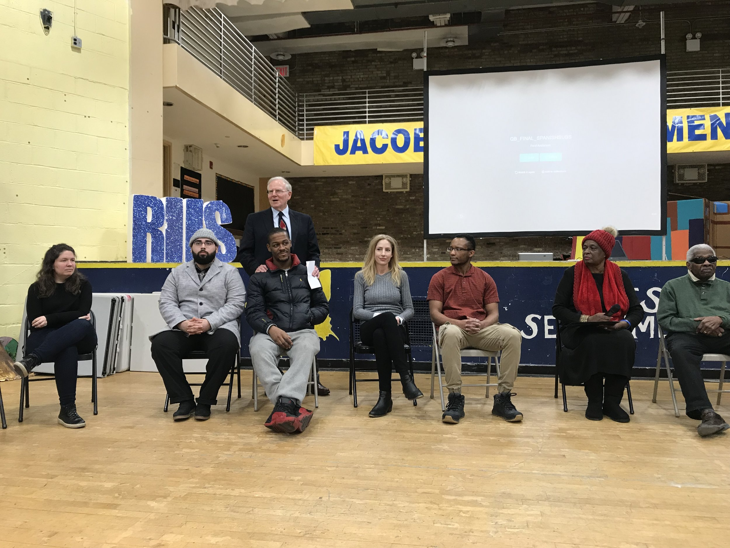 Students and residents hold a discussion of short documentary  Voices of Queensbridge , at the Jacob A. Riis Neighborhood Settlement at Queensbridge Houses. Photo by Molly Rosner.