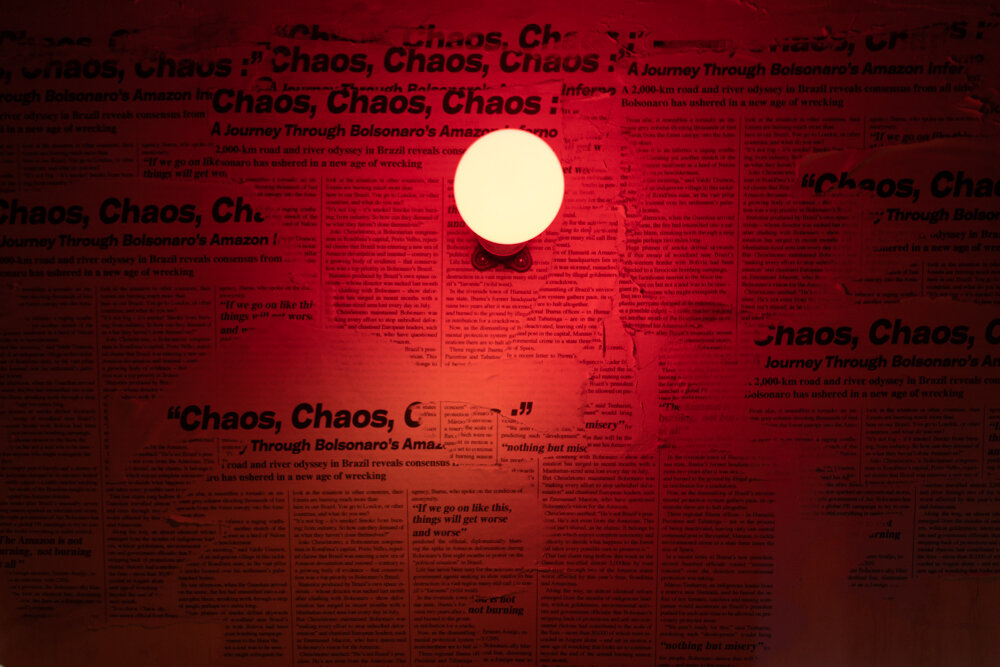 IgnisAqua.  Three channel video installation. Plywood, newsprints and blinking red light.