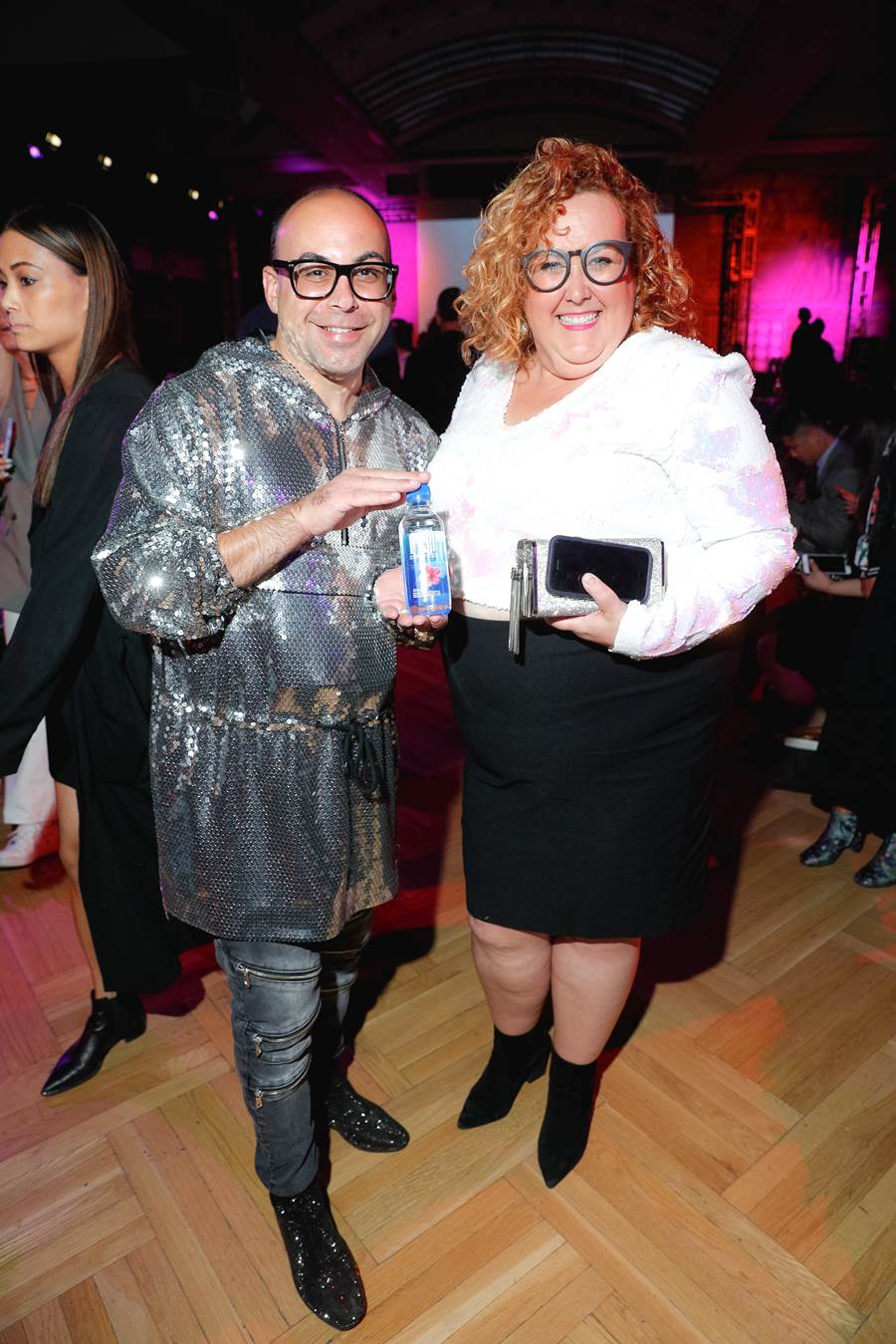 Matty Nyman and Sharron Matthews enjoying FIJI Water at Lesley Hampton's fashion show during day three of Toronto Fashion Week® - FIJI Water as the Official Water SponsorPhoto credit: Getty Images and Rock it Promotions