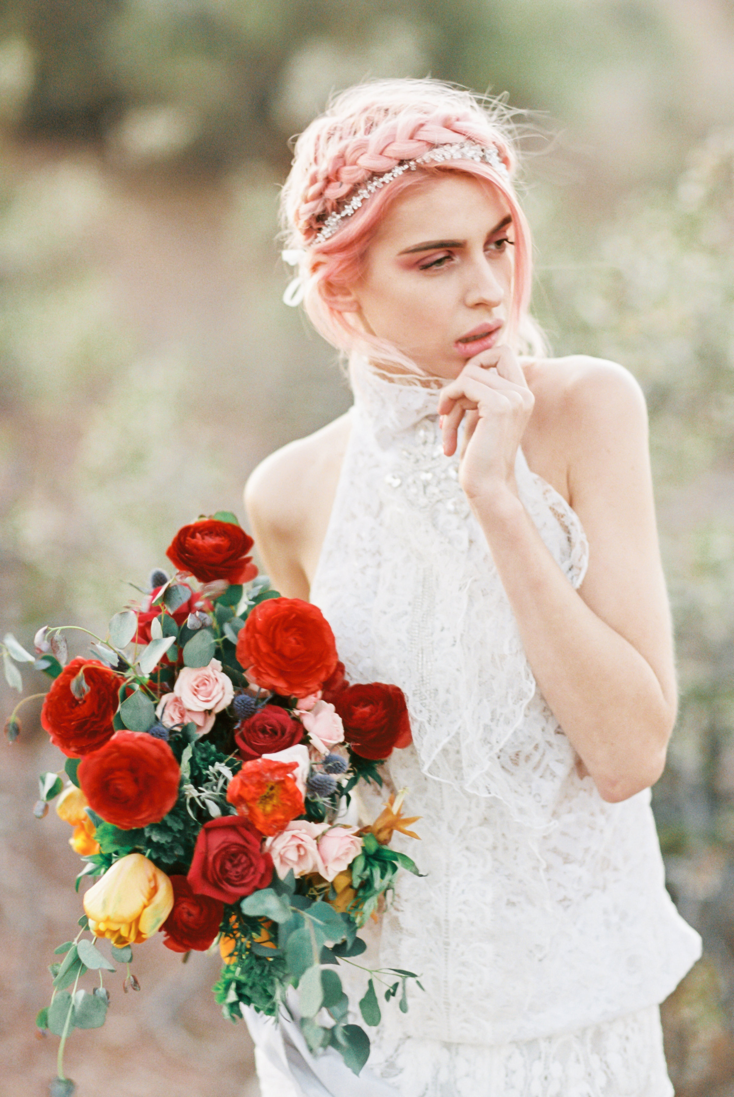 Pastel pink haired bohemian bride in one of a kind jeweled high neck lace top by Alis Fashion Design with red vintage rose bouquet.jpg