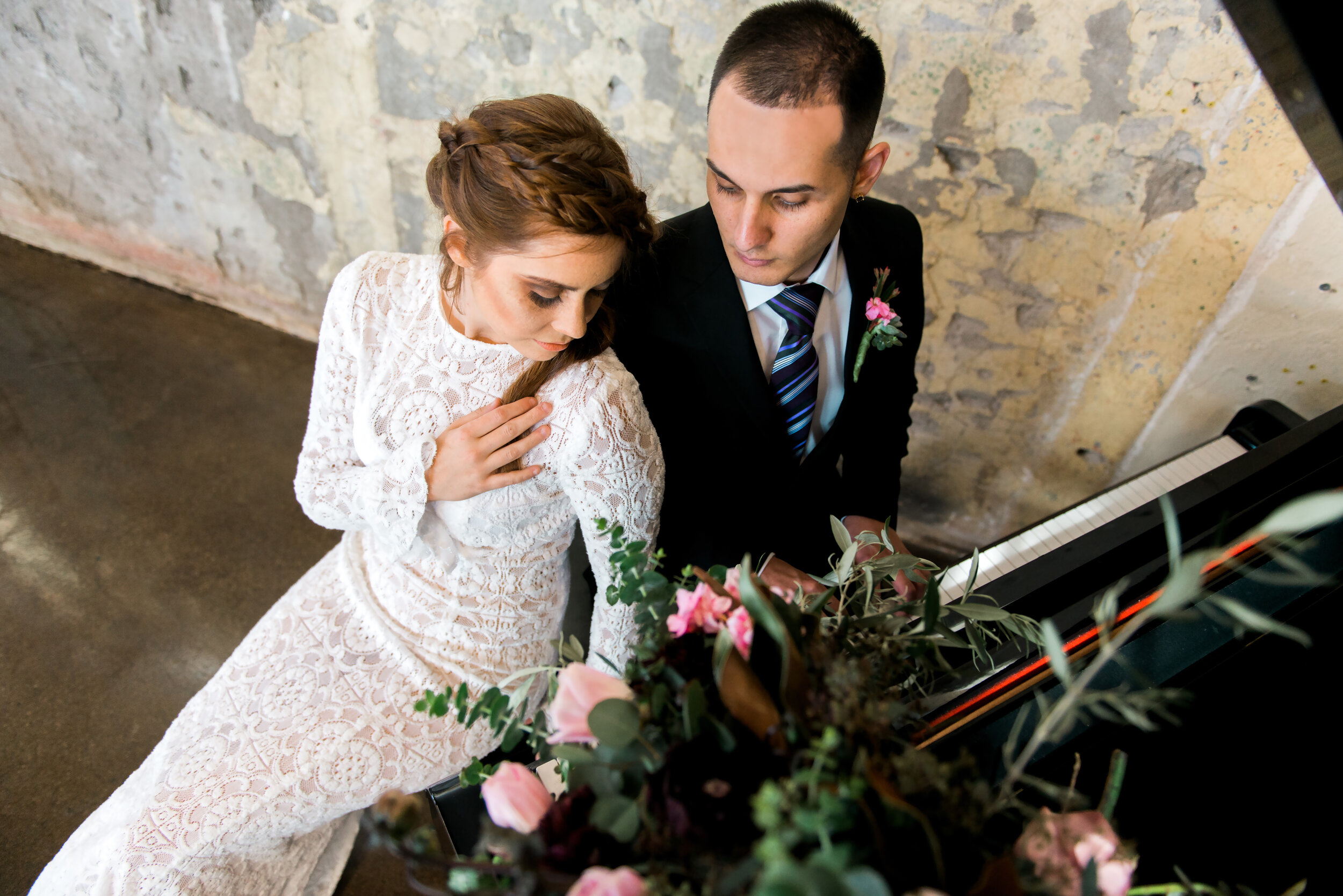 The Daily Wedding featured styled bohemian bride and groom at grand piano custom designed gown by Alis Fashion Design.jpg