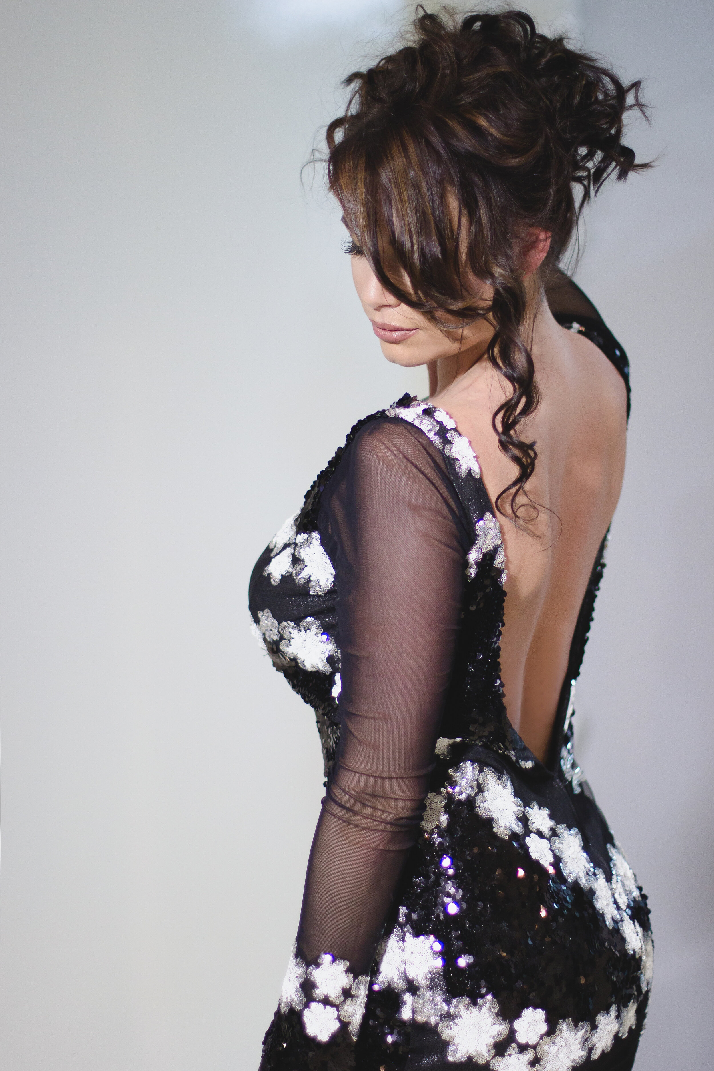 Open back long sleeved evening gown made of floral black and white sequins by Lana Gerimovich.jpg
