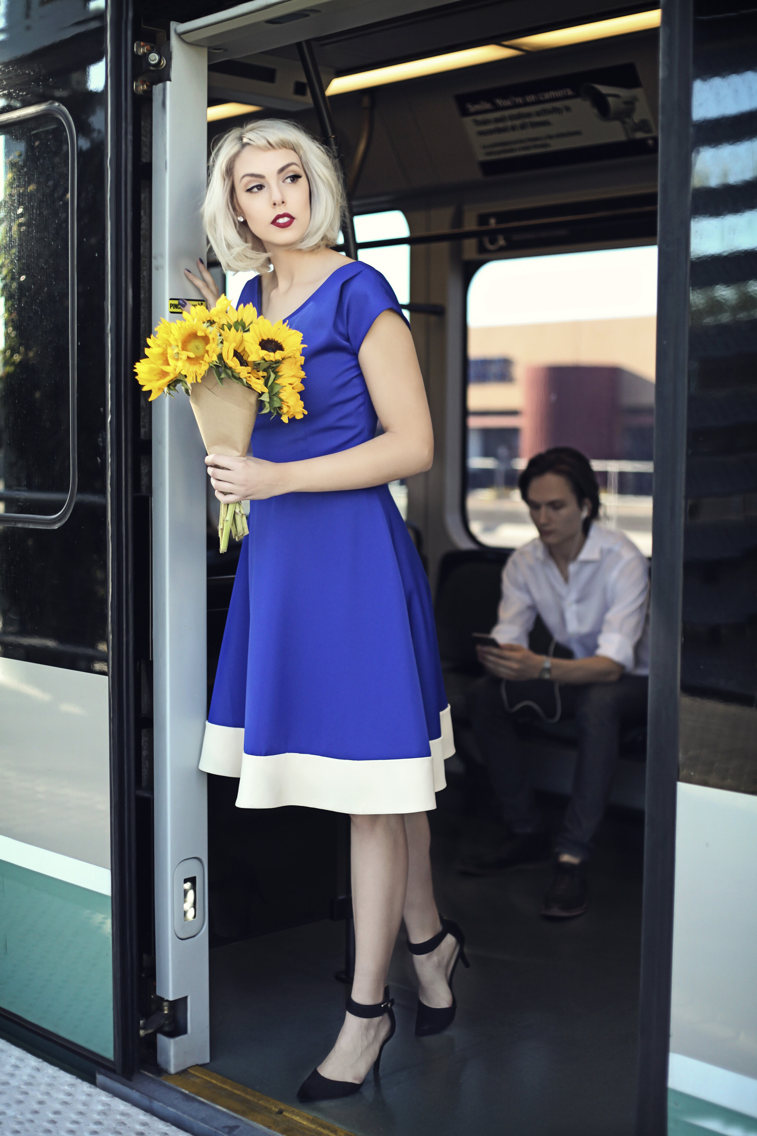 Rockabilly 50 60s swing dress custom made by Alis Fashion Design with sun flower bouquet in the train Mesa Arizona.jpg