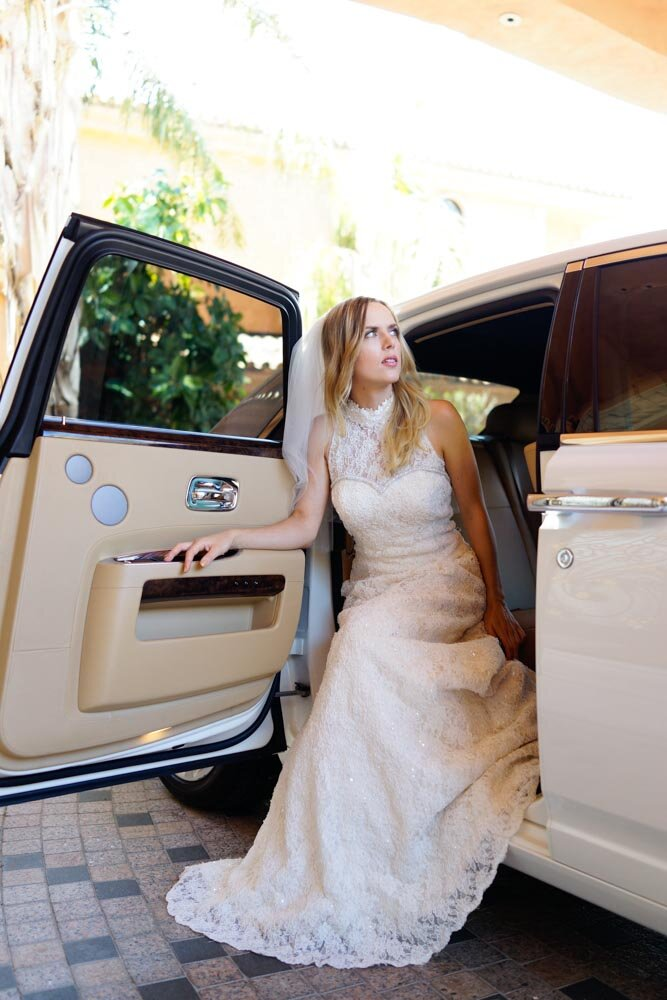 Chantilly lace A-line bespoke bridal dress trimmed with handmade swarovski crystals in a hand built Rolls Royce Ghost.jpg