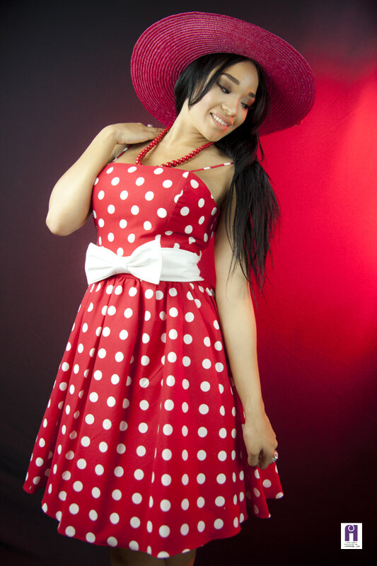 Red polka dots summer style spaghetti straps swing dress with white bow in the waistline and red hat.jpg