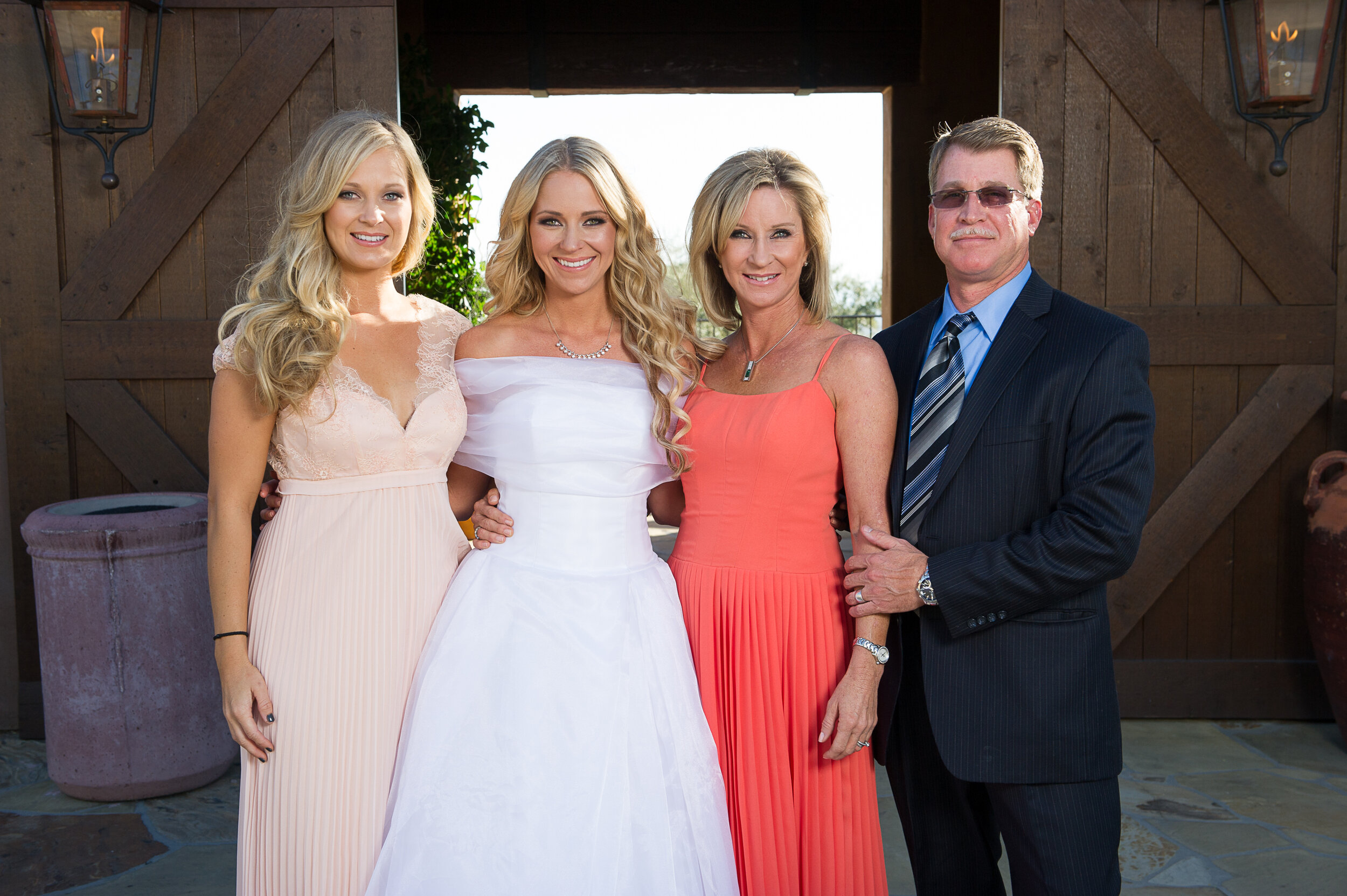 Bride in her re-designed mothers wedding dress with mother of the bride and sister of the bride at the wedding.jpg