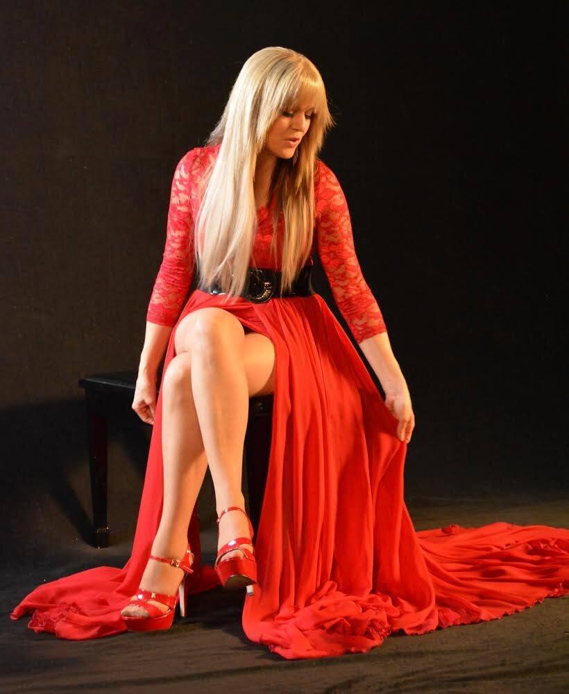Singer Joanne Jolee in custom designed flowy red maxi skirt with slits for music video by Alis Fashion Design.jpg