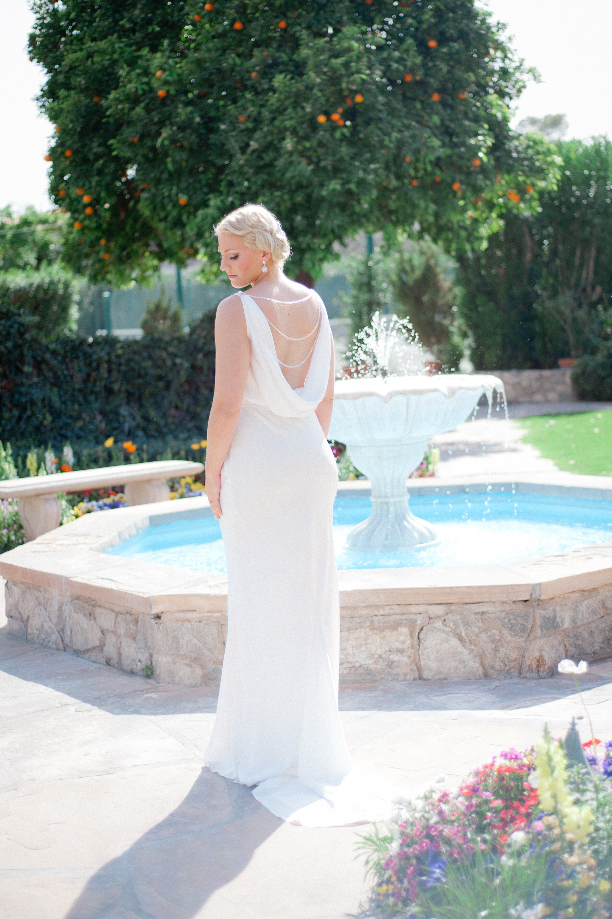 Bride in bespoke sheath floor length wedding dress draped in the back inspired by Carolynn Bessette.jpg