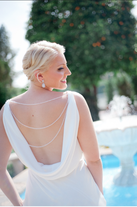 One of a kind open back wedding gown with strands of Swarovski crystals designed by Lana Gerimovich with Alis Fashion Design.png