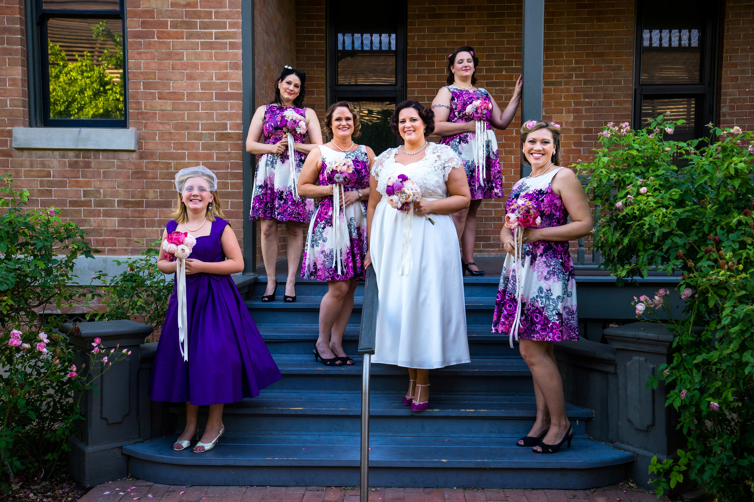 Vintage themed portrait of bride with bridesmaids and flower girl at Historic Heritage Square.jpg