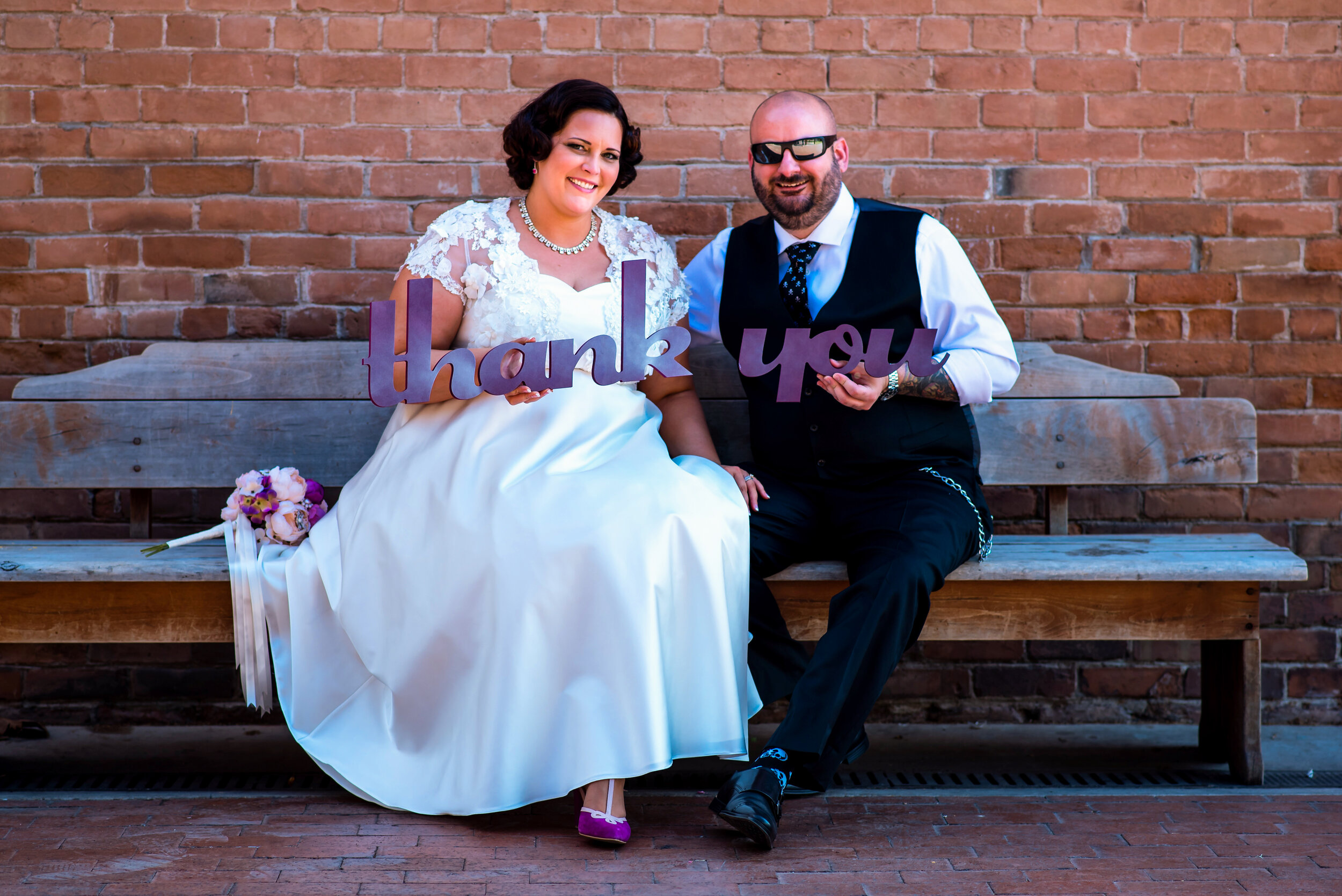 Rock N Roll themed bride and groom holding Thank You sign portrait.jpg